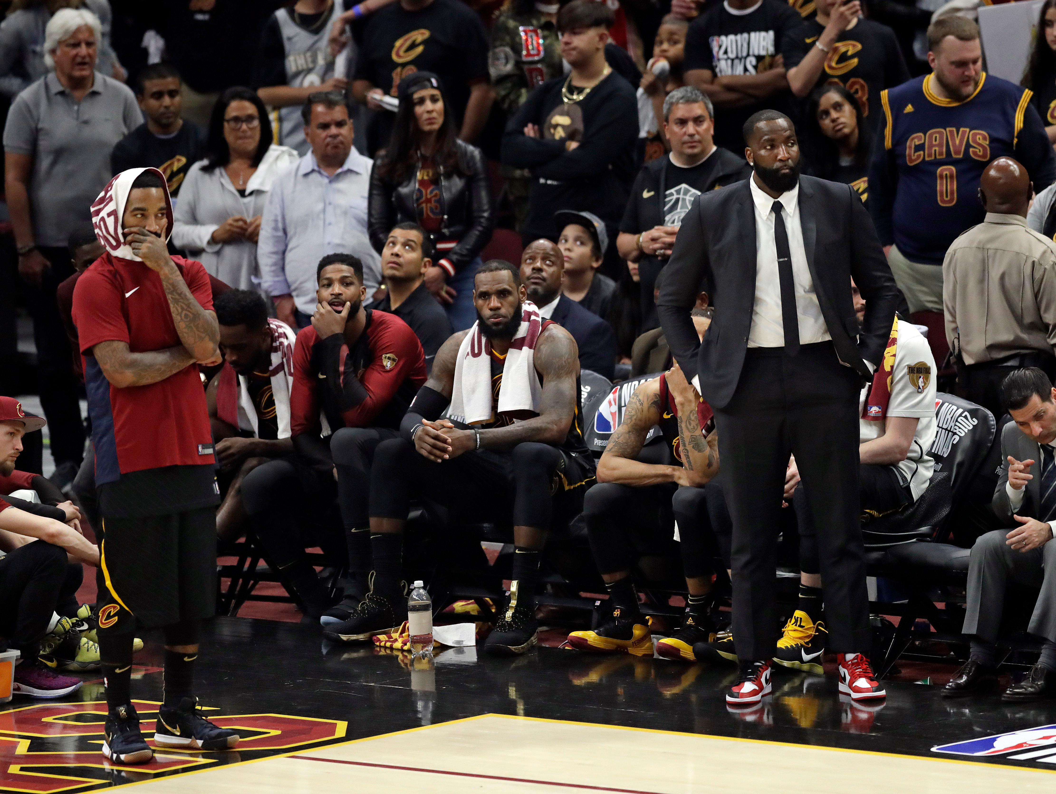 The Cleveland Cavaliers watch late in the second half of Game 4 of basketball's NBA Finals against the Golden State Warriors, Friday, June 8, 2018, in Cleveland. The Warriors defeated the Cavaliers 108-85. (AP Photo/Tony Dejak)