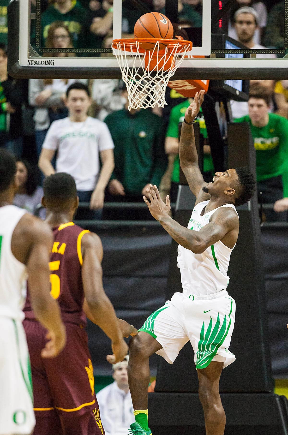 Oregon forward Jordan Bell (#1) looks up to watch his layup fall through the basket. The Oregon Ducks defeated the Arizona State Sun Devils 71 to 70. Photo by Ben Lonergan, Oregon News Lab