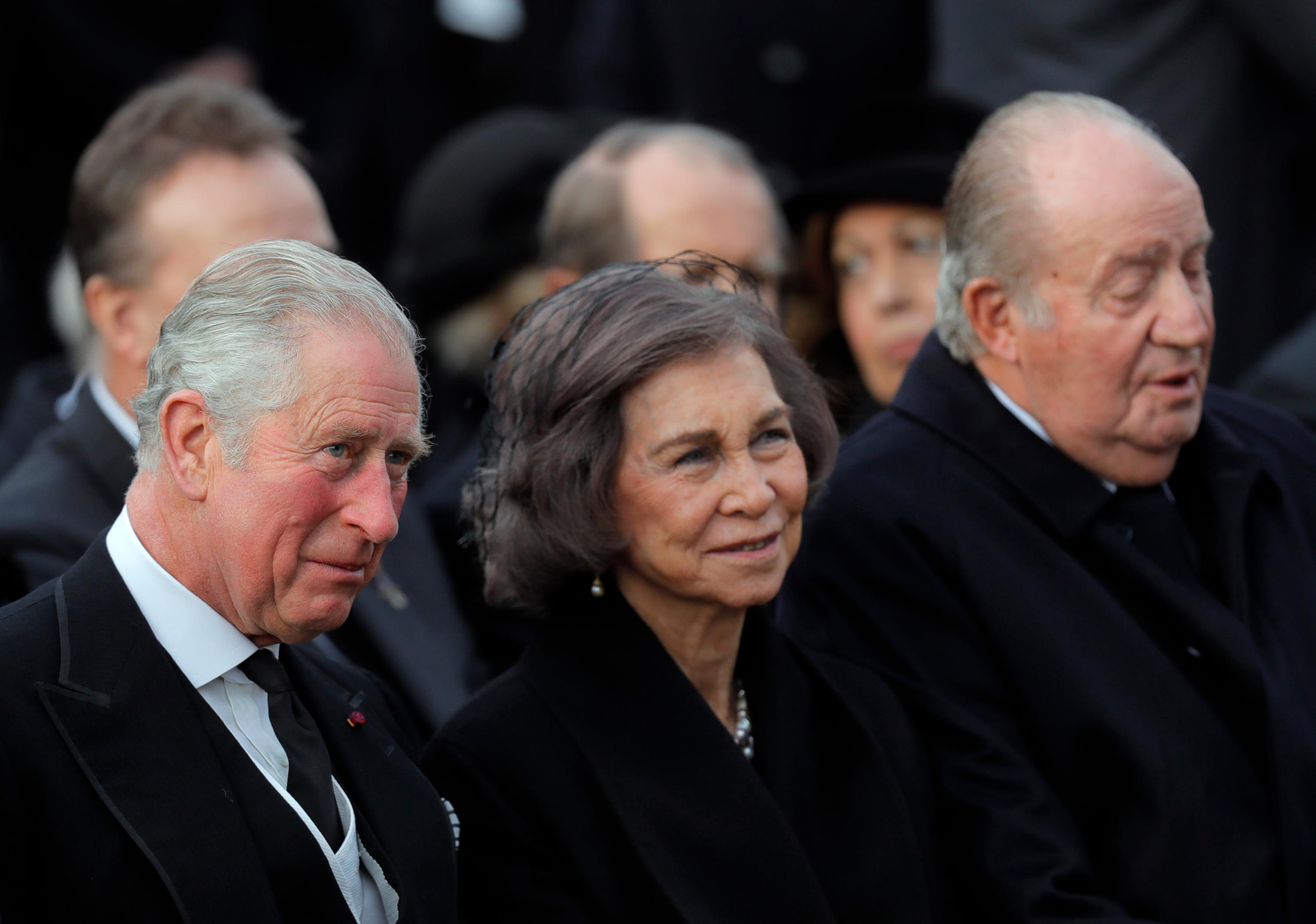 Prince Charles of Britain, left, former Spanish royals, Queen Sofia, center, and King Juan Carlos I attend the funeral ceremony in tribute to late Romanian King Michael in Bucharest, Romania, Saturday, Dec.16, 2017. Thousands waited in line to pay their respects to Former King Michael, who ruled Romania during WWII, and died on Dec. 5, 2017, aged 96, in Switzerland. (AP Photo/Vadim Ghirda)