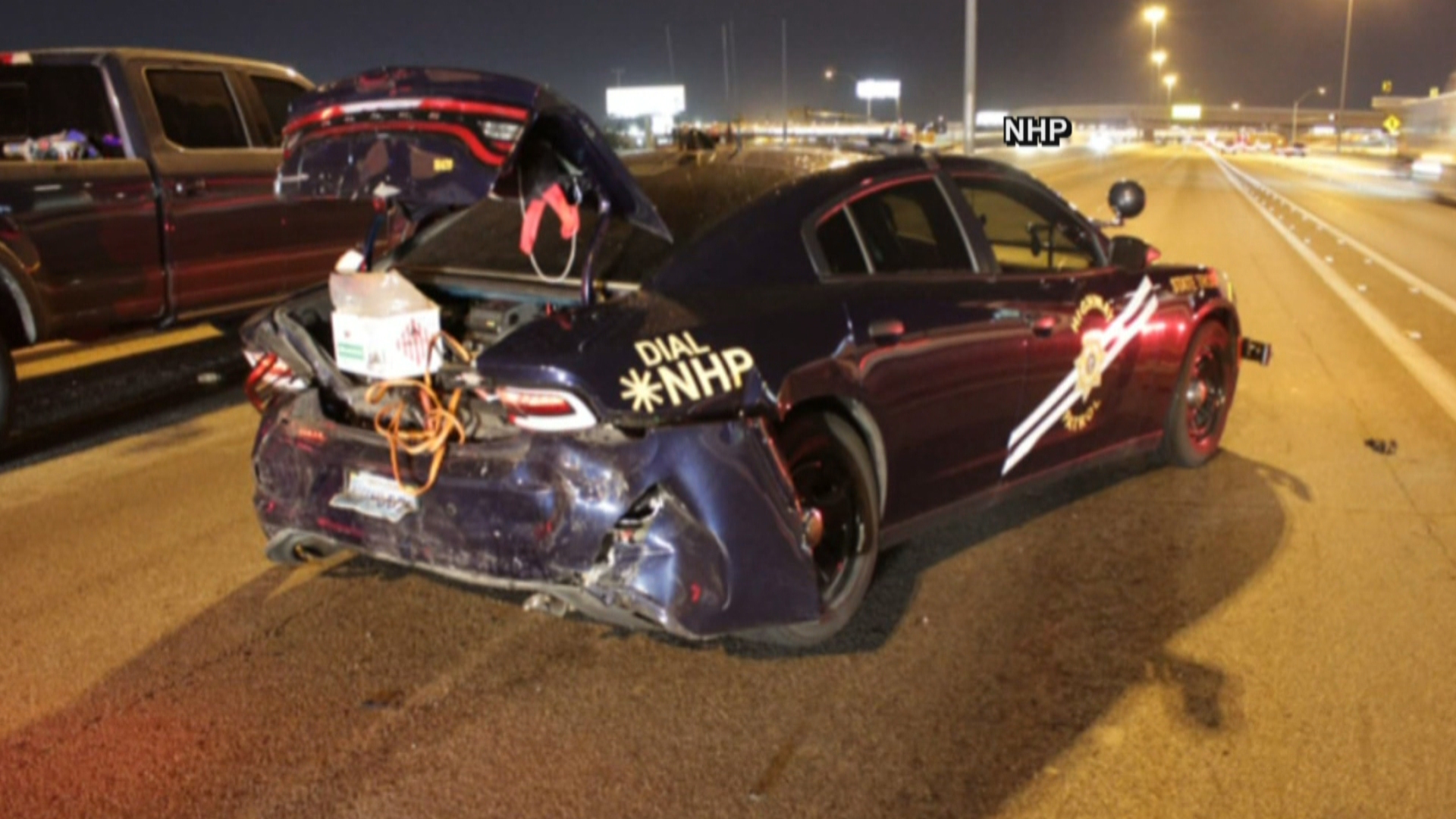It was a close call for a Nevada Highway Patrol trooper on I-15 when he was forced to jump for his life when a speeding car crashed into his cruiser.  (NHP)