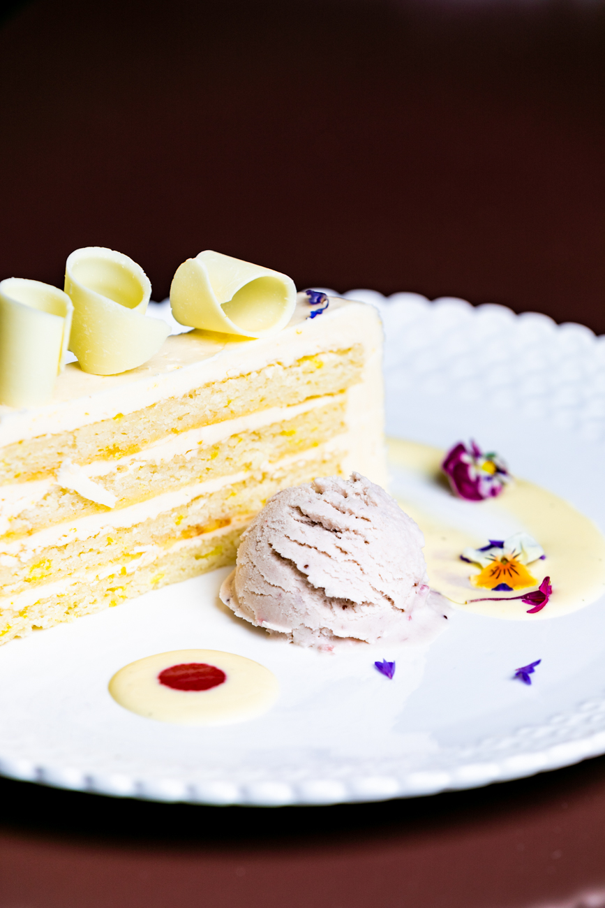 Lemon  Genoise is one of the many rotating desserts, which vary from night to night.  It's made with lemon buttercream icing and vanilla pastry cream filling and served with roasted strawberry buttermilk ice cream.  / Image: Amy Elisabeth Spasoff // Published: 1.28.19