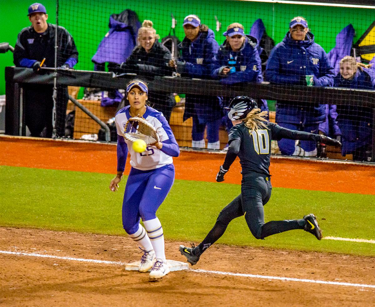 The Duck's Alexis Mack (#10) sprints for the base. In Game Two of a three-game series, the University of Oregon Ducks softball team defeated the University of Washington Huskies 4-1 Friday night in Jane Sanders Stadium. Danica Mercado (#2), Alexis Mack (#10) and Mia Camuso (#7) all scored in the win, Mack twice. The Ducks play the Huskies for the tie breaker on Saturday with the first pitch at noon. Photo by August Frank, Oregon News Lab