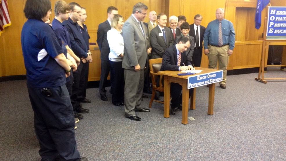 Gov. Scott Walker signs heroin-related HOPE legislation package into law in Marinette, April 7, 2014. (WLUK/Bill Miston)