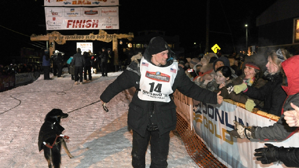Dallas Seavey greets fans after winning the 2014 Iditarod Trail Sled Dog Race in Nome, Alaska, Tuesday, March 11, 2014. (AP Photo/The Anchorage Daily News, Bob Hallinen)