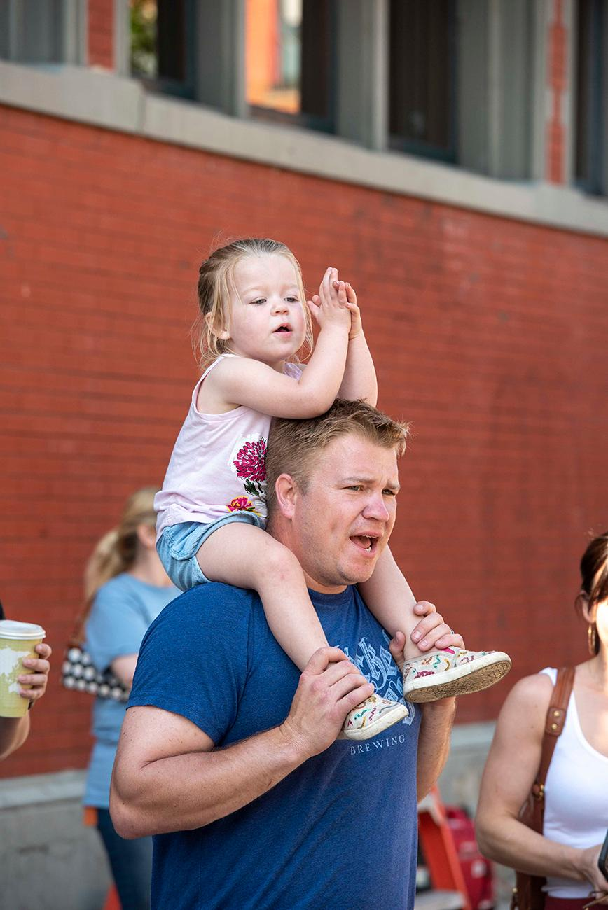 Spectators cheer the runners as they sprint near the finish line on 13th Street. / Image: Joe Simon // Published: 5.19.19