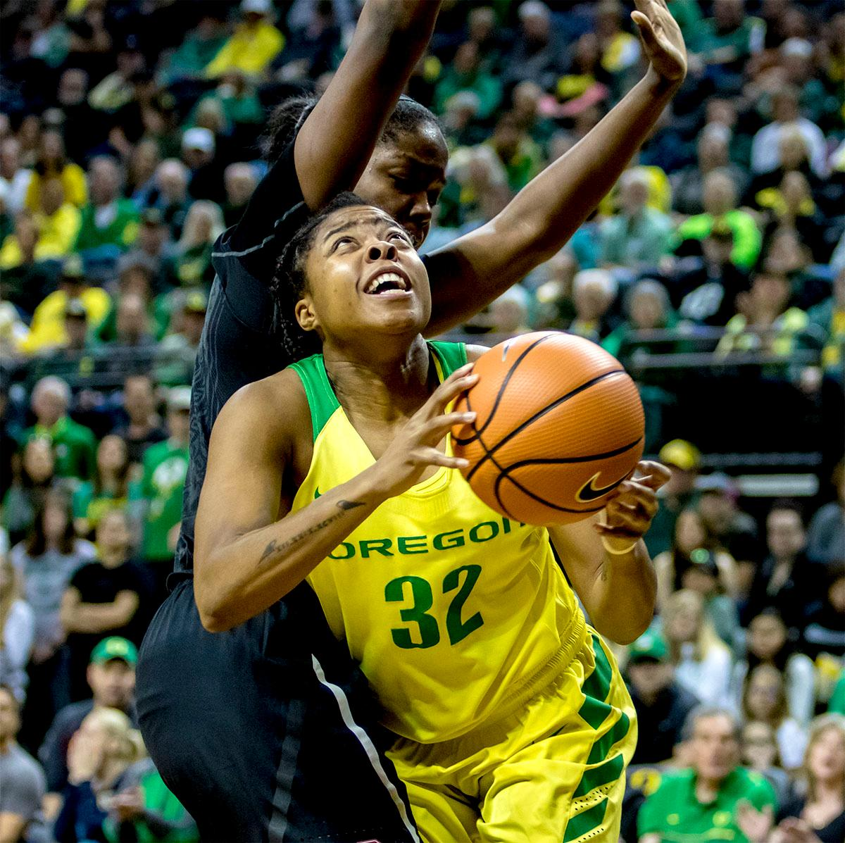 The Duck's Oti Gildon (#32) makes the rebound. The Stanford Cardinal defeated the Oregon Ducks 78-65 on Sunday afternoon at Matthew Knight Arena. Stanford is now 10-2 in conference play and with this loss the Ducks drop to 10-2. Leading the Stanford Cardinal was Brittany McPhee with 33 points, Alanna Smith with 14 points, and Kiana Williams with 14 points. For the Ducks Sabrina Ionescu led with 22 points, Ruthy Hebard added 16 points, and Satou Sabally put in 14 points. Photo by August Frank, Oregon News Lab