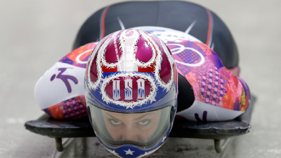 Noelle Pikus-Pace of the United States starts her third run during the women's skeleton competition at the 2014 Winter Olympics, Friday, Feb. 14, 2014, in Krasnaya Polyana, Russia. (AP Photo/Natacha Pisarenko)