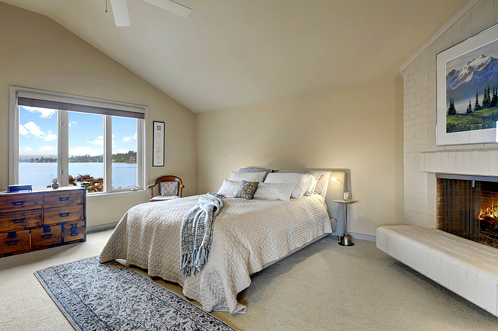 The master bedroom has its own fireplace and stunning lake views.