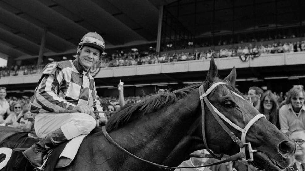 In this June 9, 1973 file photo, jockey Ron Turcotte walks Secretariat towards the winners circle after they captured the Triple Crown by winning the Belmont Stakes at Belmont Park in Elmont, N.Y. (AP Photo/File)
