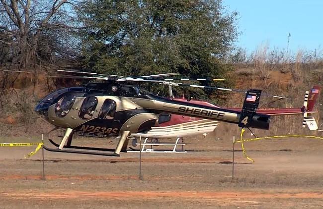 Law enforcement helicopters in Midland City, Ala. on Friday, February 1, 2013 for the hostage standoff with Jimmy Lee Dykes.