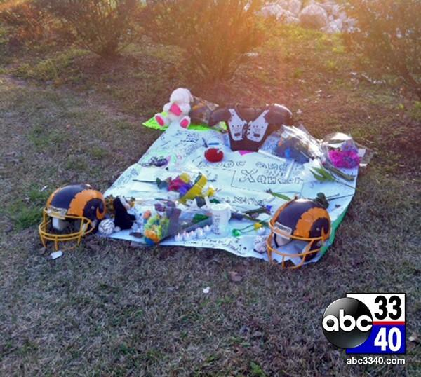 A tribute for the victims of plane crash in Colorado was set up in a grassy area outside Mitchell Elementary School in Gadsden, Ala., Monday, March 23, 2014.