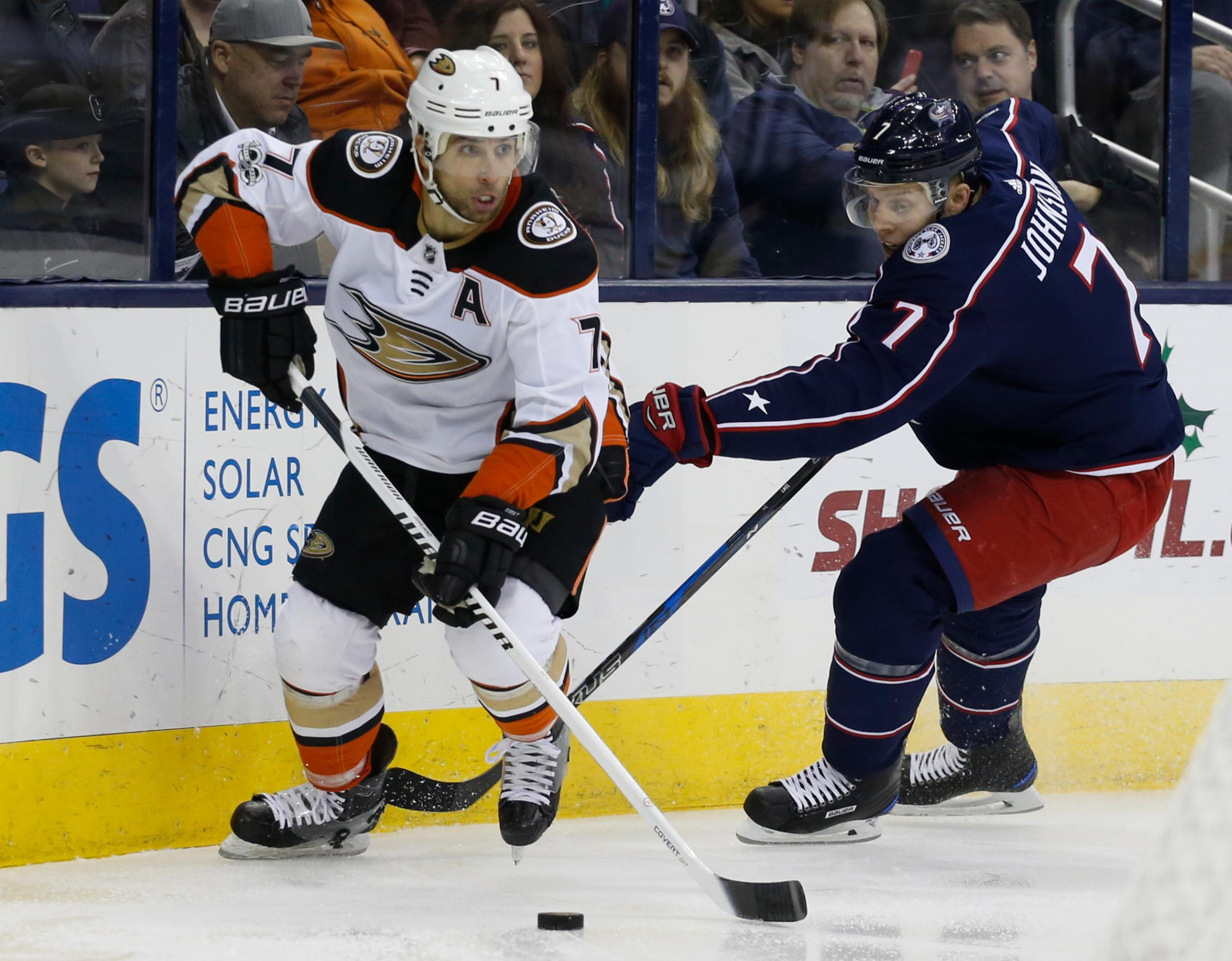 Anaheim Ducks' Andrew Cogliano, left, looks for an open pass as Columbus Blue Jackets' Jack Johnson defends during the first period of an NHL hockey game Friday, Dec. 1, 2017, in Columbus, Ohio. (AP Photo/Jay LaPrete)