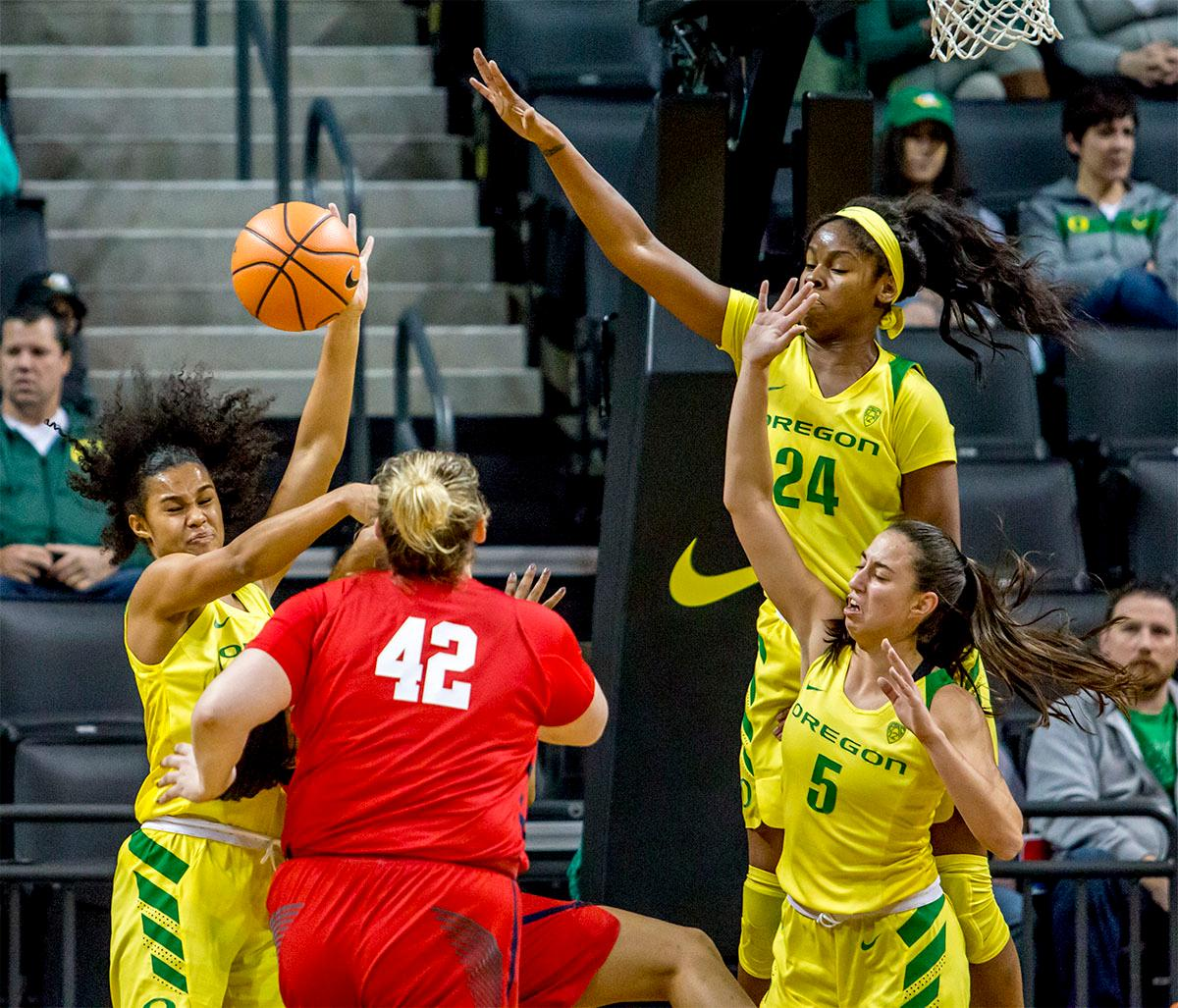 The Duck's jump in to catch the rebound against the Rebels. The Duck's Sabrina Ionescu (#20) is introduced at the start of the game against the Ole Miss Rebels. The Oregon Ducks womens basketball team defeated the Ole Miss Rebels 90-46 on Sunday at Matthew Knight Arena. Sabrina Ionescu tied the NCAA record for triple-doubles, finishing the game with 21 points, 14 assists, and 11 rebounds. Ruthy Hebard added 16 points, Satou Sabally added 12, and both Lexi Bando and Maite Cazorla scored 10 each. The Ducks will next face off against Texas A&M on Thursday Dec. 21 and Hawaii on Friday Dec. 22 in Las Vegas for Duel in the Desert before the start of Pac-12 games. Photo by August Frank, Oregon News Lab