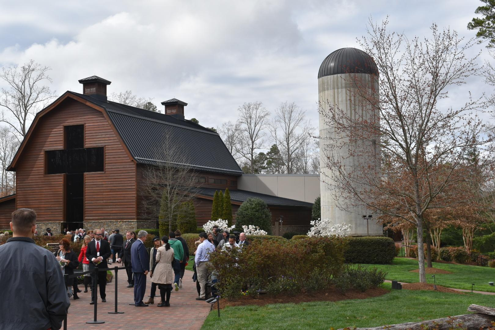 People gather at the Billy Graham Library in Charlotte, North Carolina, on Feb. 26, 2018, to pay respects to the late Reverend Billy Graham, who died on Feb. 21. (Photo credit: WLOS Staff)