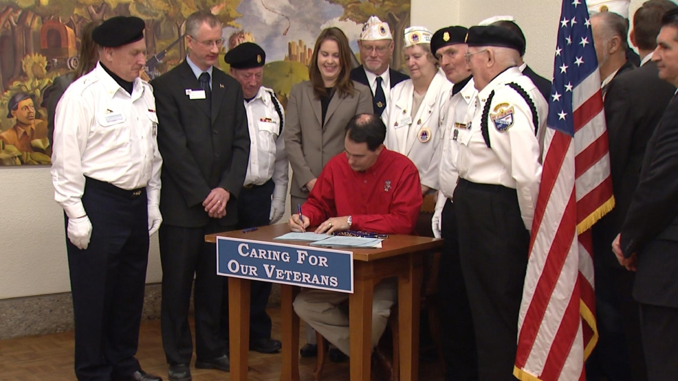 Gov. Scott Walker signed six bills related to veterans services at the King Veterans Home, April 4, 2014. (WLUK/Chad Doran)