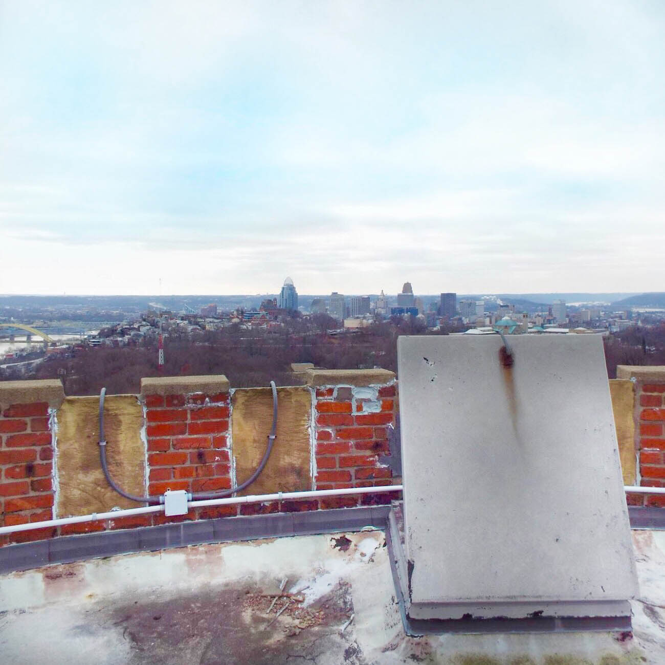 The final stairs lead to a metal hatch door and out onto the observation deck roof to a breathtaking view of downtown Cincinnati. / Image: Amy Bauer // Published: 3.14.19