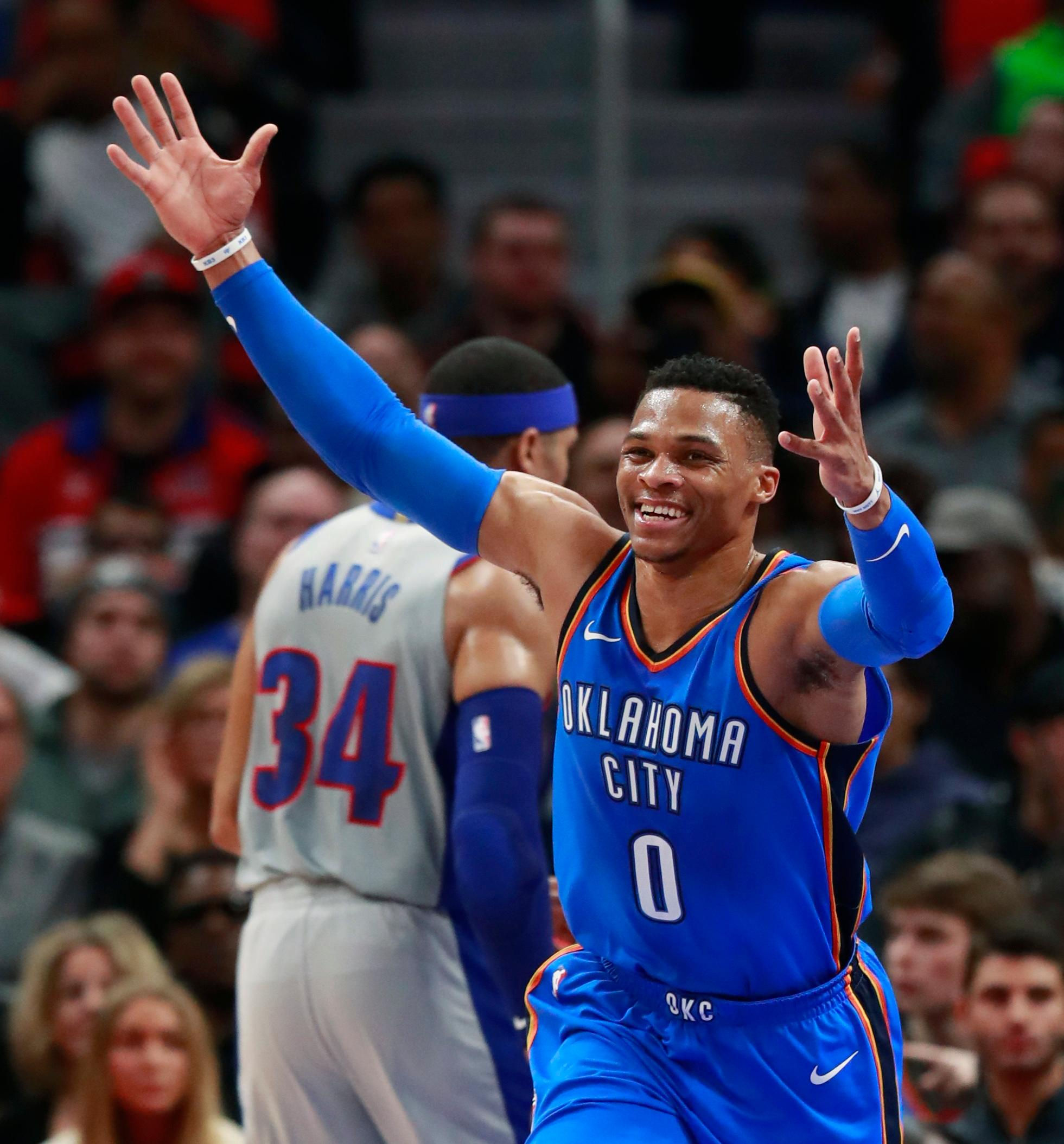 Oklahoma City Thunder guard Russell Westbrook (0) reacts after a play during the first half of the team's NBA basketball game against the Detroit Pistons, Saturday, Jan. 27, 2018, in Detroit. (AP Photo/Carlos Osorio)