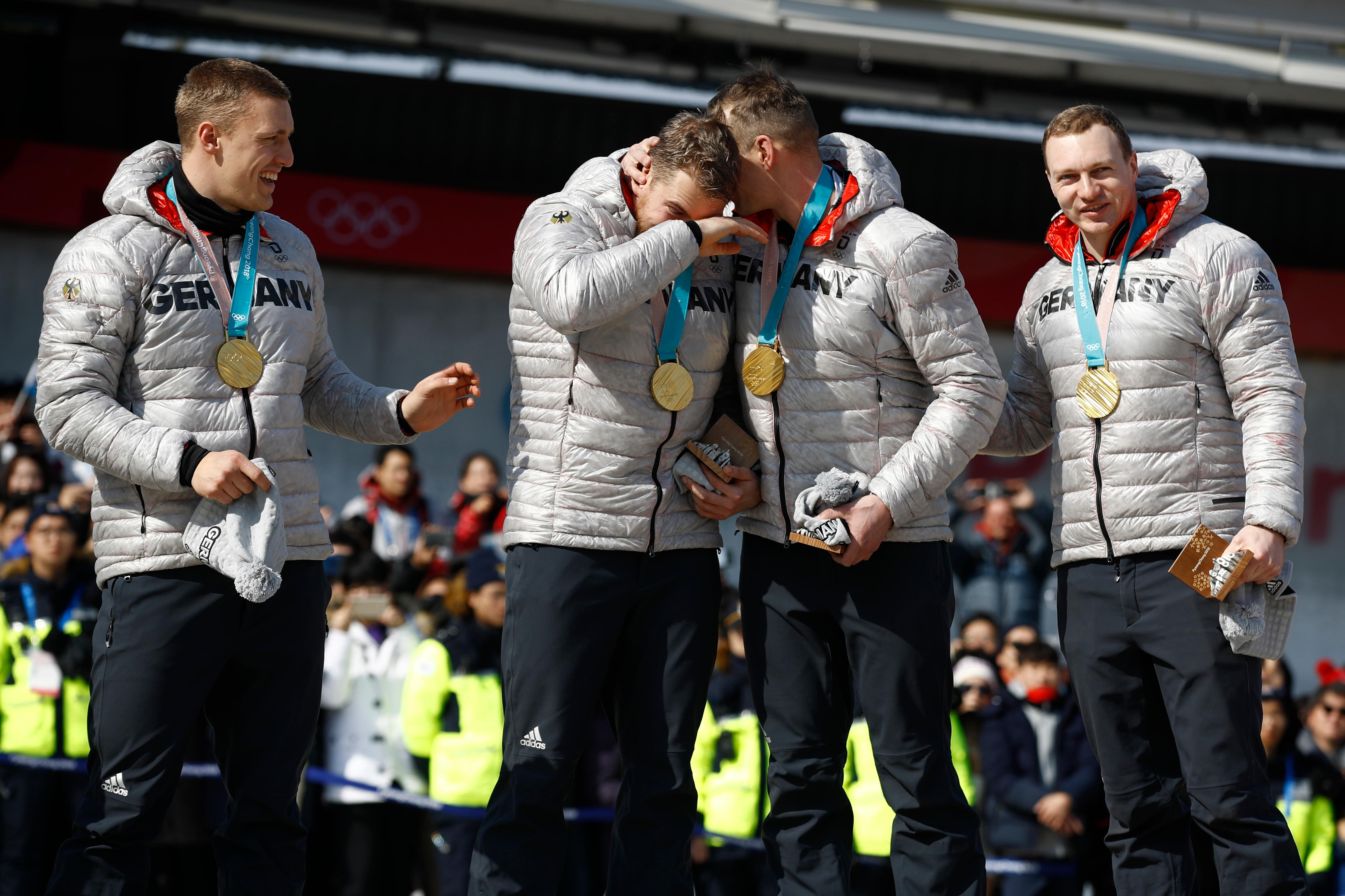 Gold Medalists driver Francesco Friedrich, Candy Bauer, Martin Grothkopp and Thorsten Margis of Germany celebrate during the medals ceremony after winning the four-man bobsled competition final at the 2018 Winter Olympics in Pyeongchang, South Korea, Sunday, Feb. 25, 2018. (AP Photo/Patrick Semansky)