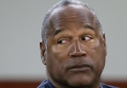 FILE - In this May 13, 2013 file photo, O.J. Simpson appears at an evidentiary hearing in Clark County District Court, in Las Vegas.  The former football star appeared in Hertz ads for more than a decade and came to be associated with the rental car company. Simpson had continued making appearances at events for the company. That ended in 1994 when he was charged with first-degree murder of ex-wife Nicole Brown and friend Ronald Goldman.  (AP Photo/Julie Jacobson, Pool, File)