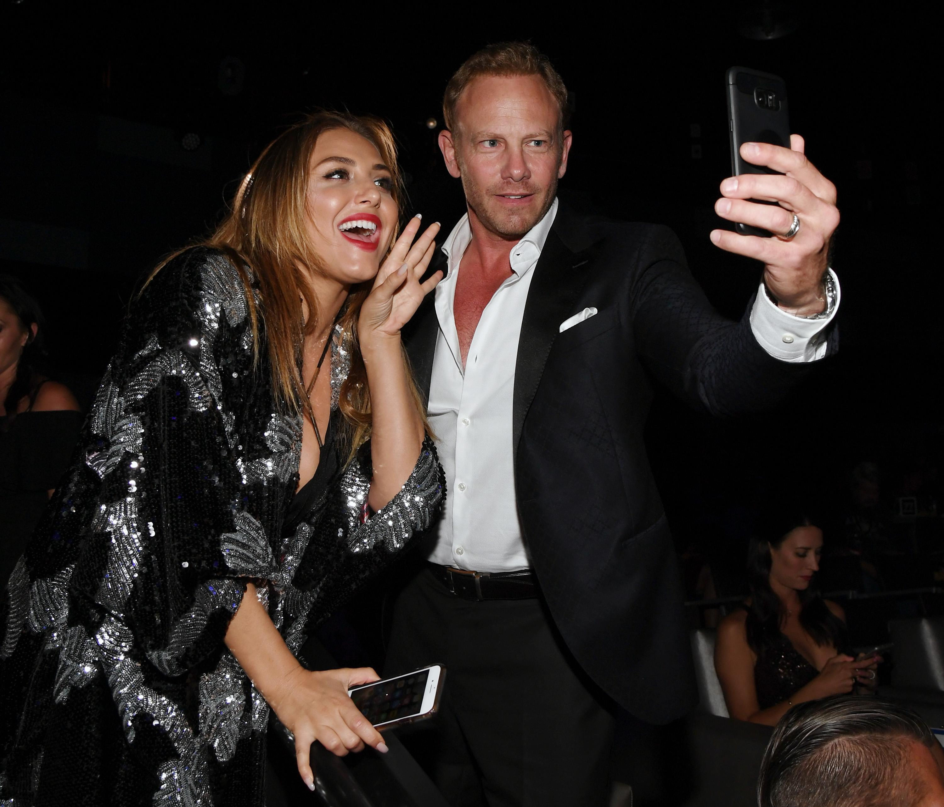 "LAS VEGAS, NV - AUGUST 06:  Actress Cassie Scerbo (L) and actor Ian Ziering live-stream during the premiere of ""Sharknado 5: Global Swarming"" at The LINQ Hotel & Casino on August 6, 2017 in Las Vegas, Nevada.  (Photo by Ethan Miller/Getty Images for Caesars Entertainment )"