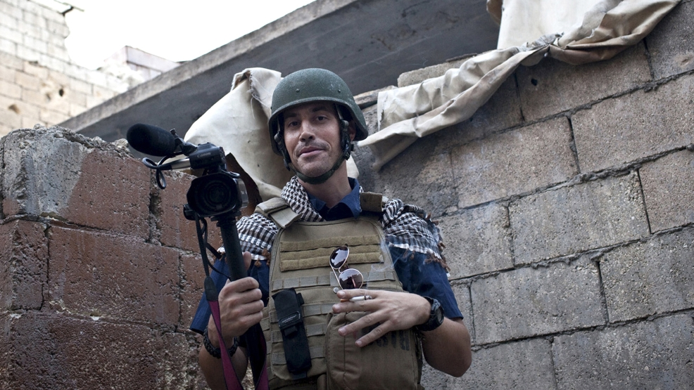 In this November 2012, file photo, posted on the website freejamesfoley.org, shows American journalist James Foley while covering the civil war in Aleppo, Syria. In a horrifying act of revenge for U.S. airstrikes in northern Iraq, militants with the Islamic State extremist group have beheaded Foley — and are threatening to kill another hostage, U.S. officials say. (AP Photo/freejamesfoley.org, Nicole Tung, File)