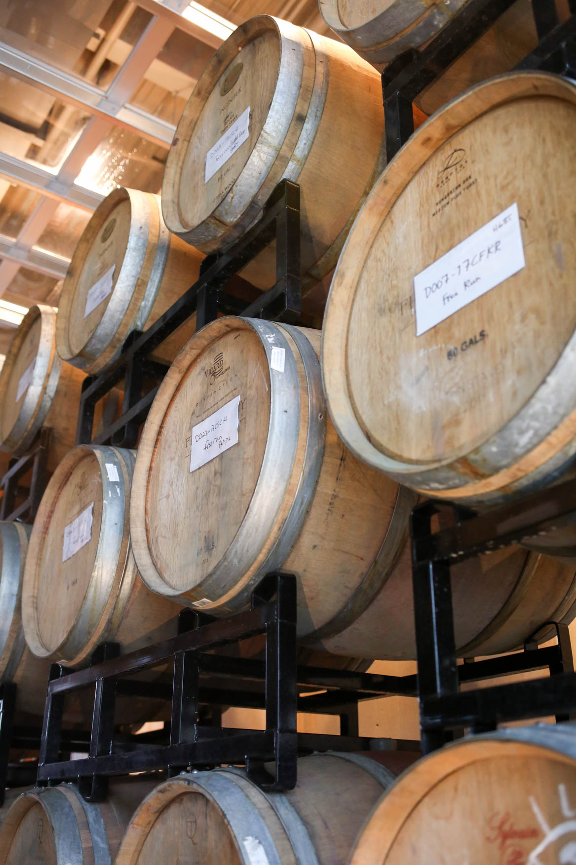 The barrels are filled with wine, but the amount of time the wine spends in the barrel depends on its blend and the type of wine being made. (Amanda Andrade-Rhoades/DC Refined)<p></p>