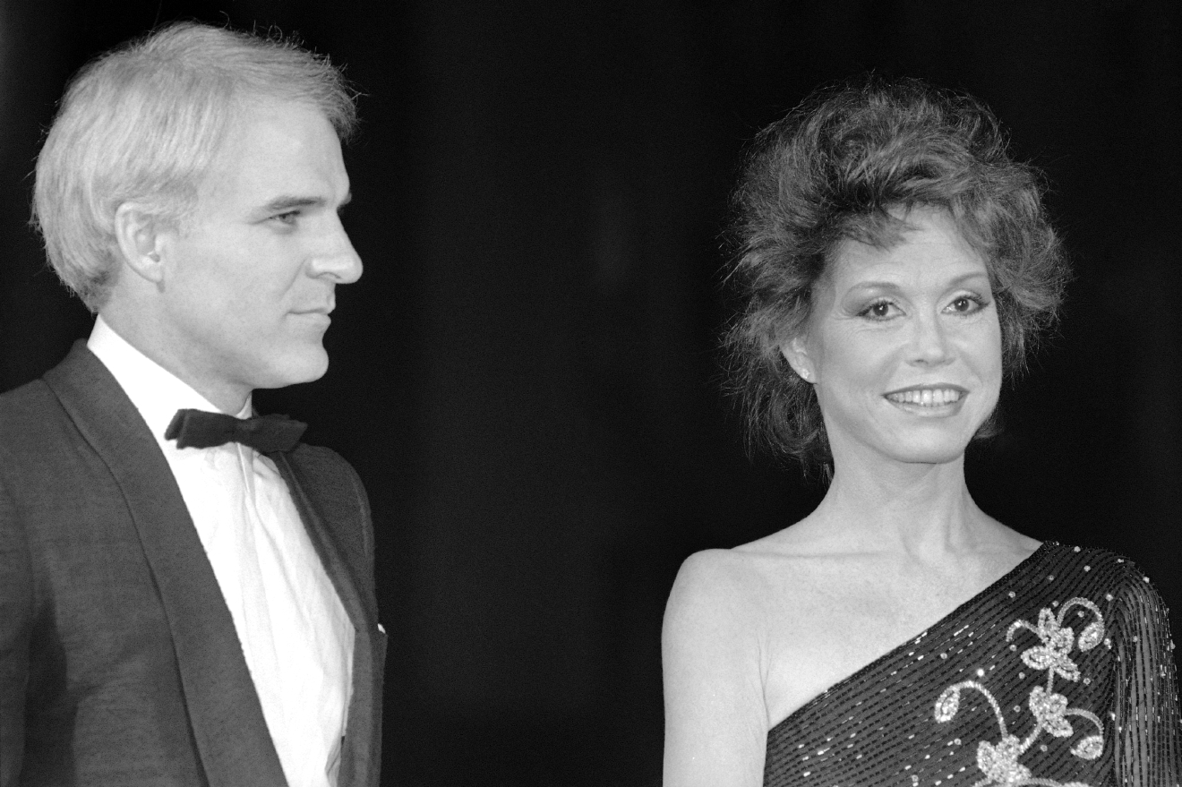 Actress Mary Tyler Moore, one of the stars of the new film ?Six Weeks? from Universal, smiles as she arrives at the film?s charity premiere with guest Steve Martin, Monday, Dec. 7, 1982 in Los Angeles. Film also stars Dudley Moore. (AP Photo/Nick Ut)