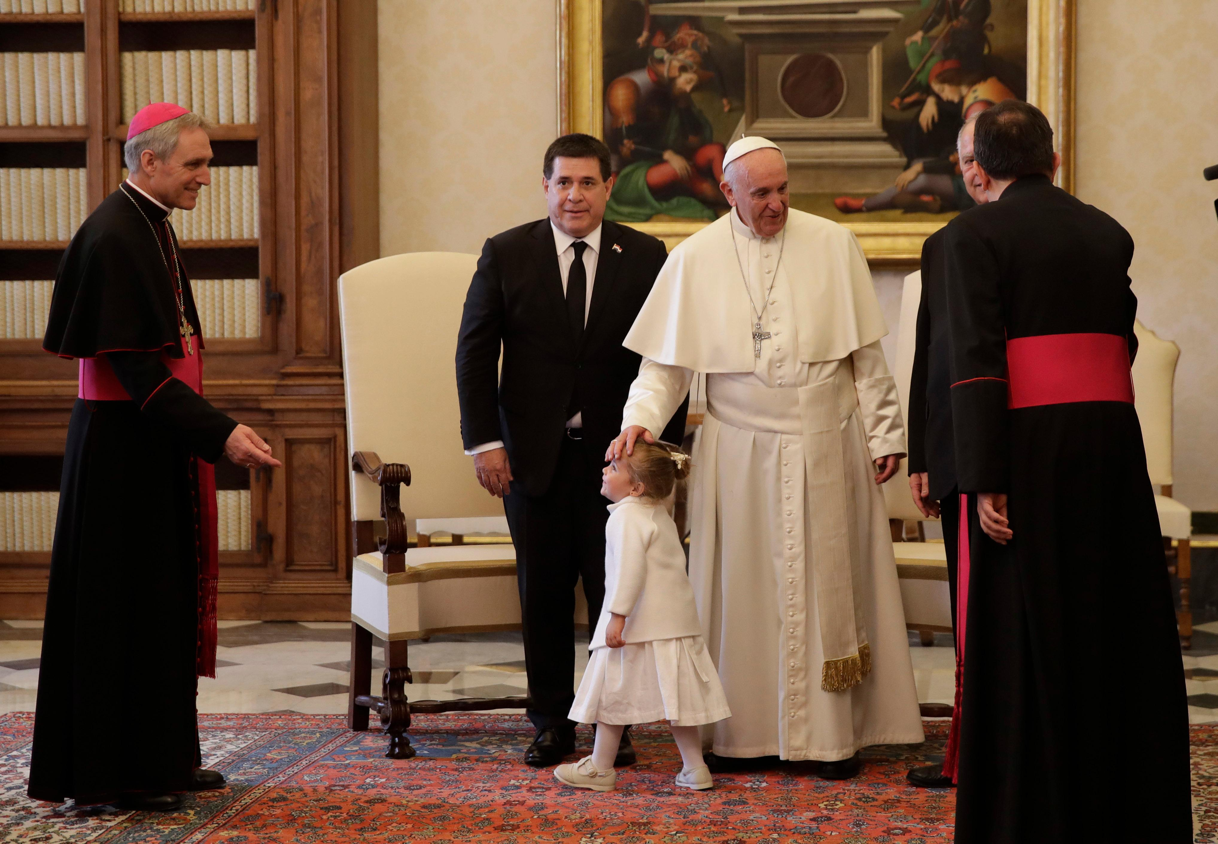 Pope Francis meets Paraguay's President Horacio Cartes and his grandniece Sofia during a private audience at the Vatican Thursday, Nov. 9, 2017. (AP Photo/Alessandra Tarantino)