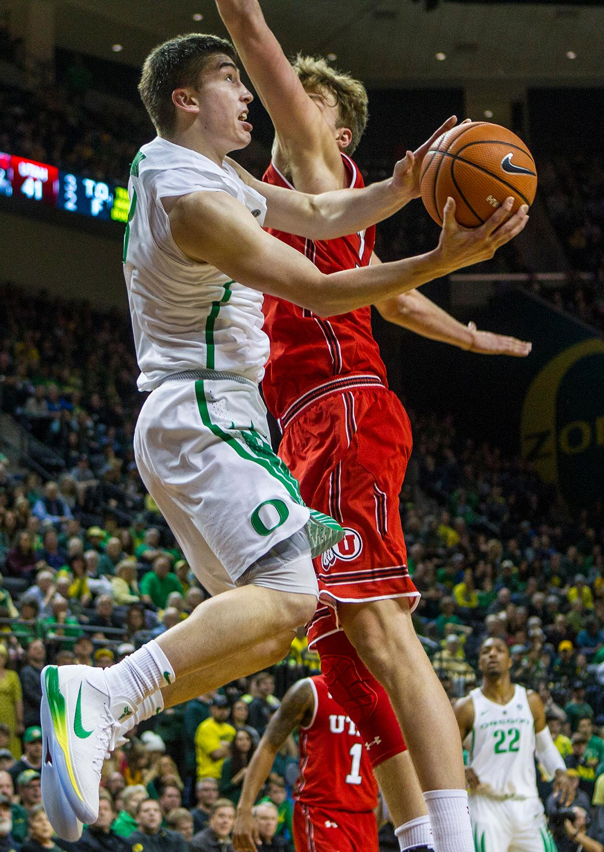 Oregon Ducks Payton Pritchard (#3) looks for the basket as he is pressured by Utah's defense. The Utah Utes defeated the Oregon Ducks 66-56 on Friday night at Matthew Knight Arena. This is the first Pac-12 conference game loss at home for the Ducks since January of 2015. This also ended the five home game winning streak for the Ducks against the Utah Utes. Photo by Rhianna Gelhart, Oregon News Lab