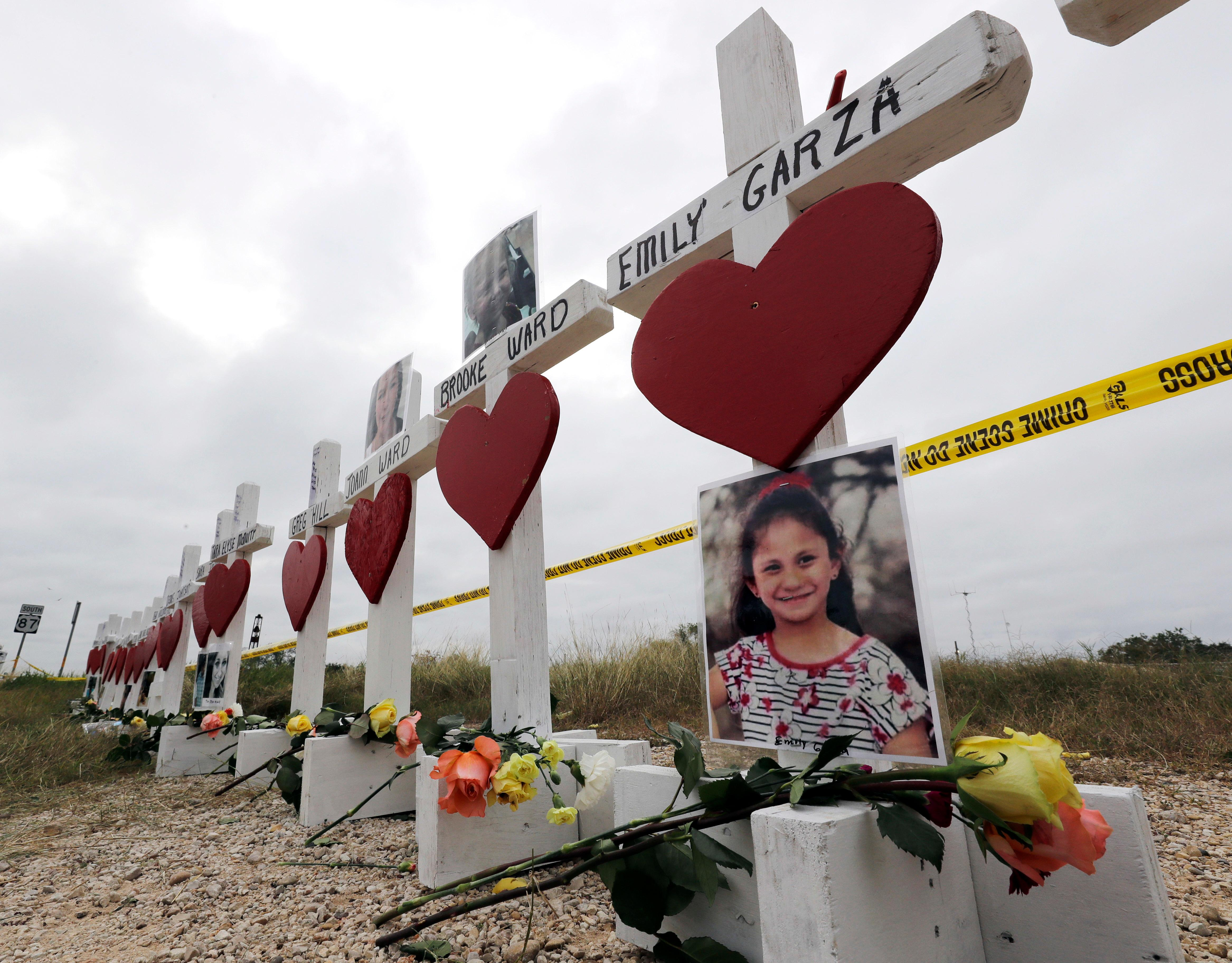 Crosses showing shooting victims names stand near the First Baptist Church on Thursday, Nov. 9, 2017, in Sutherland Springs, Texas. A man opened fire inside the church in the small South Texas community on Sunday, killing more than two dozen and injuring others. (AP Photo/David J. Phillip)
