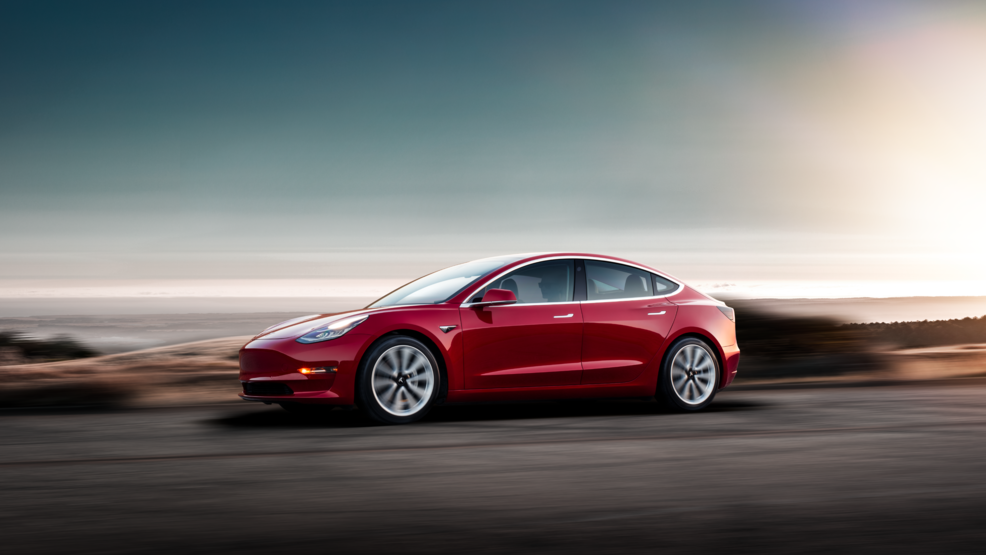 Model 3 - Red Driving Sunset.png
