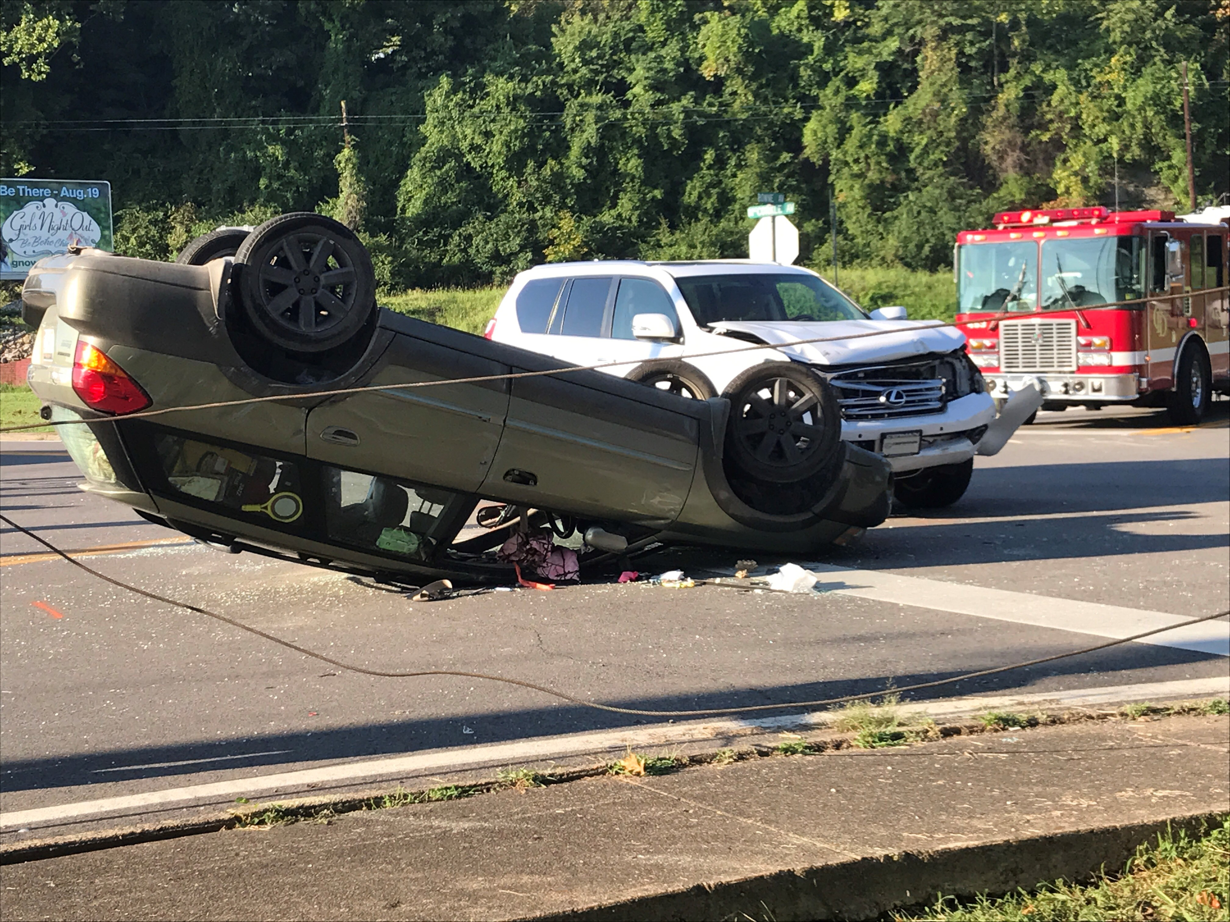 A vehicle is overturned following a Thursday morning crash on MacCorkle Avenue near the Patrick Street Bridge. (WCHS/WVAH)
