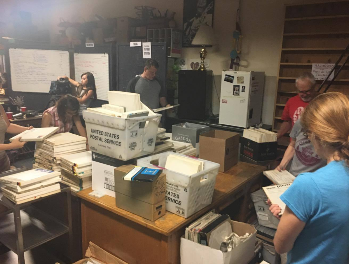 About 25 people showed up to the clean-up, most of them volunteers. They sifted through boxes of film reels separating KOPN material and scanning music and information to save digitally on drives. (Gabriella Nuñez/ KRCG13)