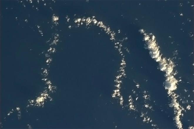 Just south of the Galapagos, this cloud is waiting for you to draw a face. (Photo & Caption: Col. Chris Hadfield, NASA)