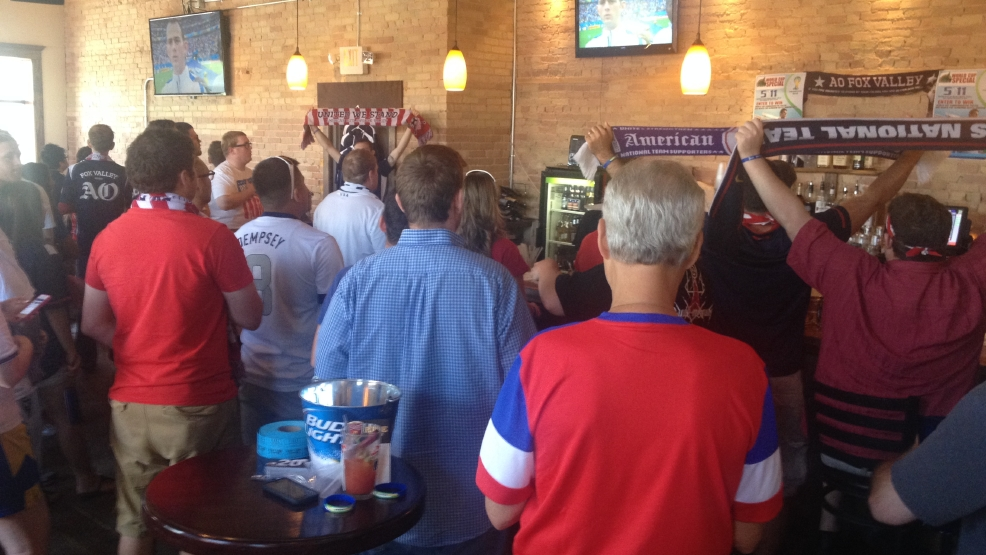 Diehards and occasional fans turn out to watch US loss in Neenah, advance to next World Cup round.