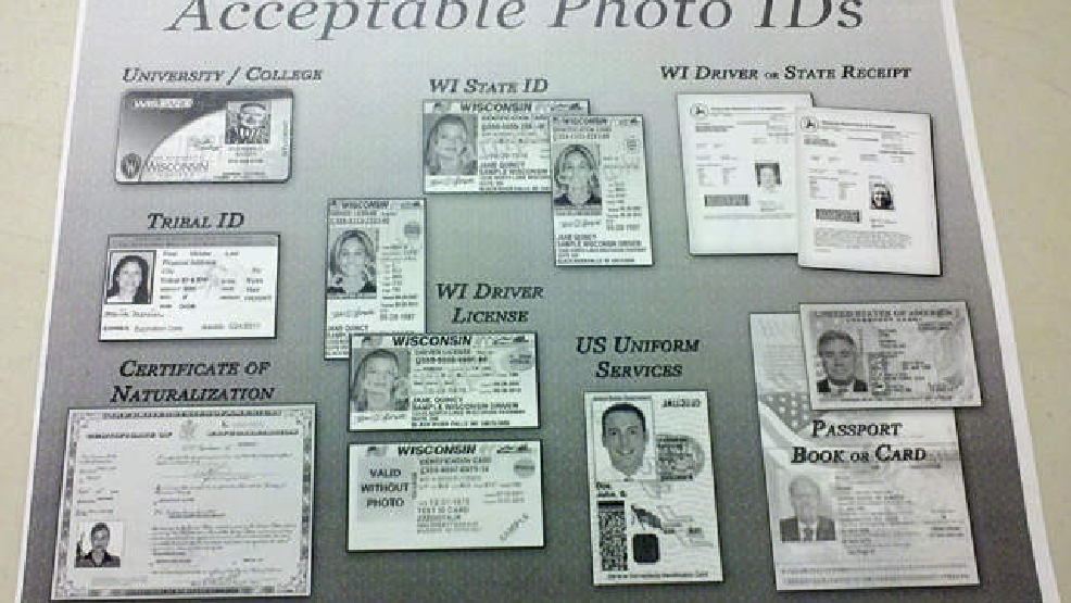Display showing acceptable forms of photo identification for voting in Wisconsin during a 2012 election. (File photo)