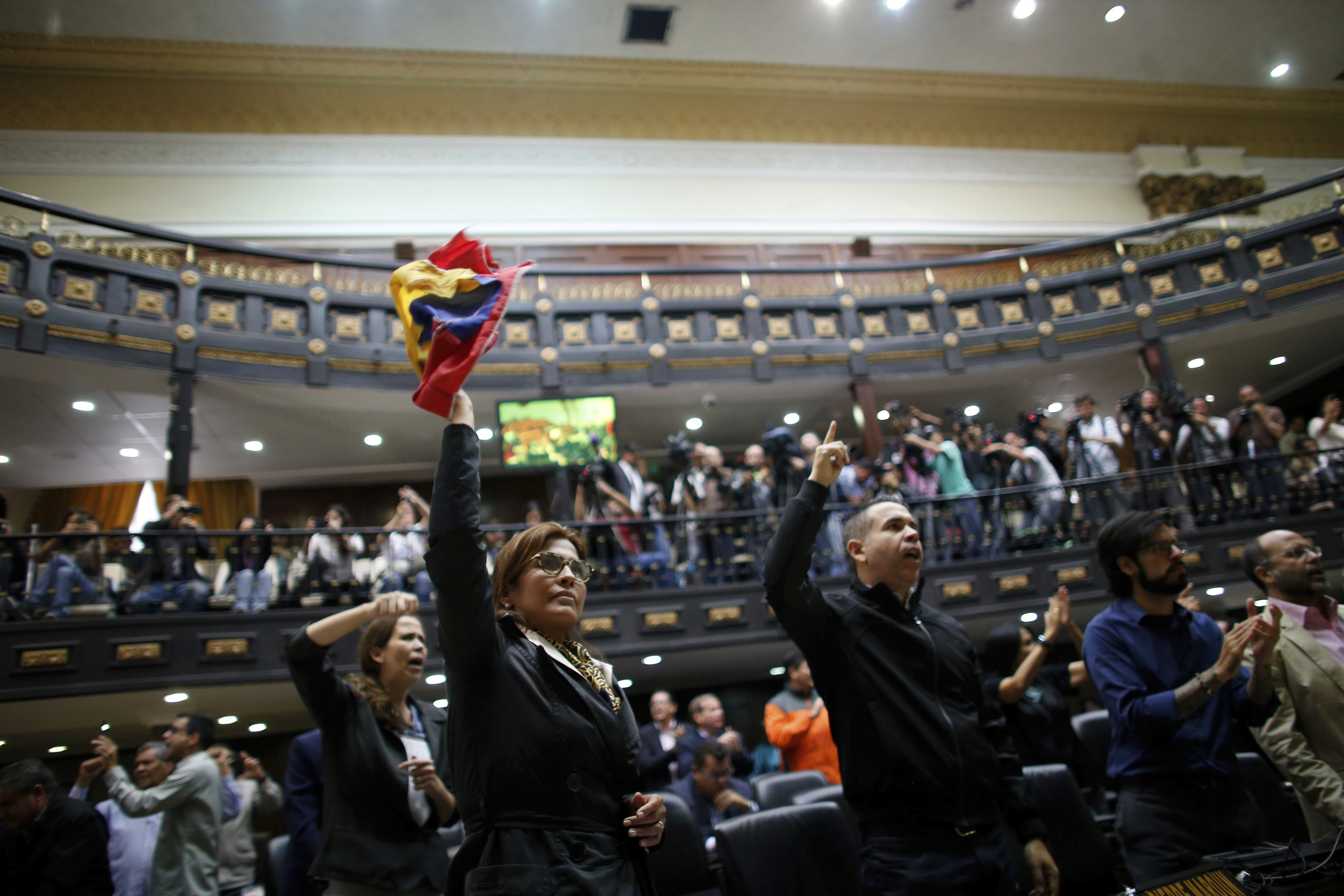 "Anti-government lawmakers shout ""Fraud,"" during a session of Venezuela's National Assembly, in Caracas, Venezuela, Wednesday, Aug. 2, 2017. The National assembly's claim of a fraudulent election was bolstered when the CEO of the voting technology company Smartmatic said Wednesday that results of Venezuela's election for the all-powerful constituent assembly were off by at least 1 million votes. (AP Photo/Ariana Cubillos)"