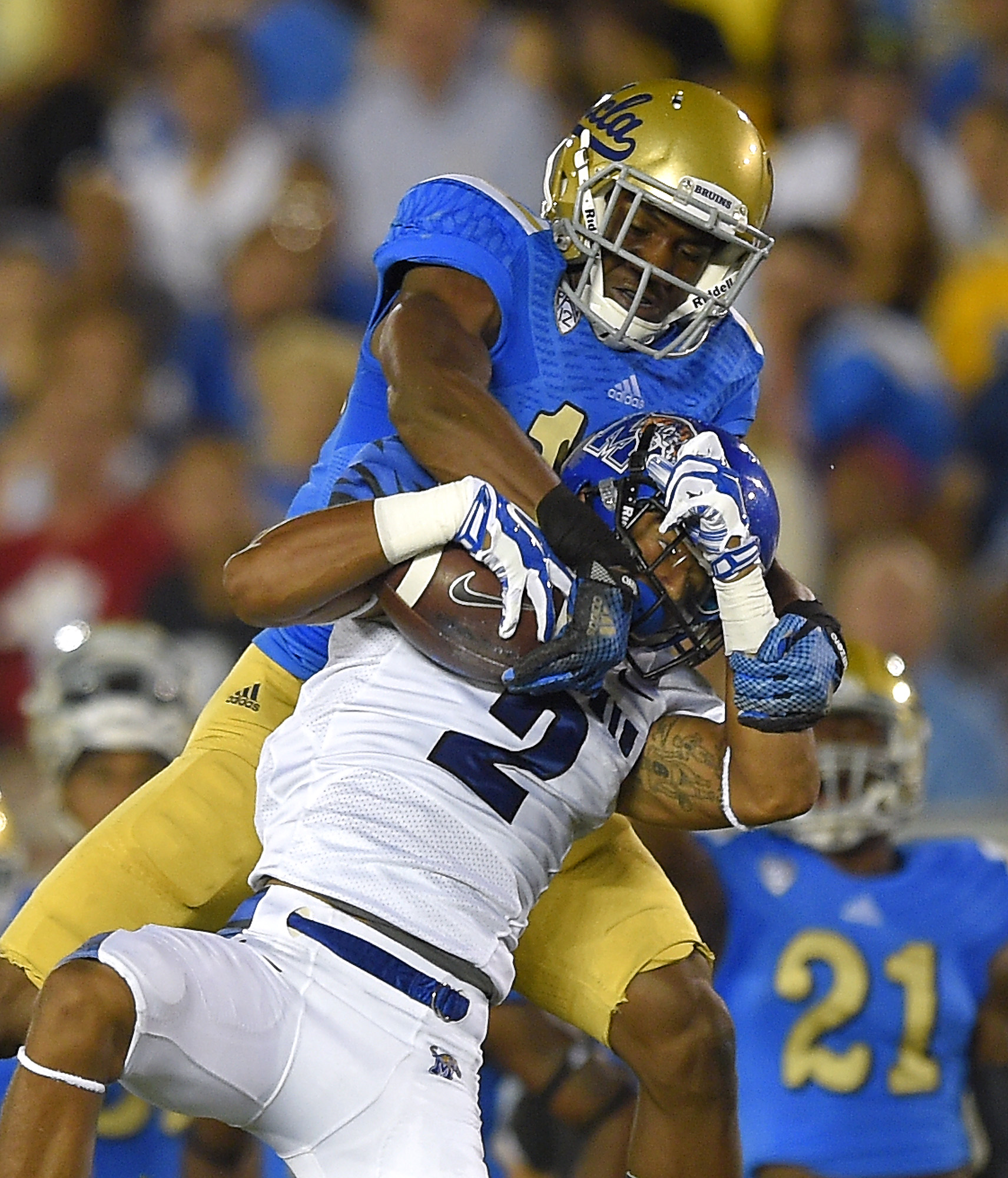 Fabian Moreau was selected by the Redskins in the third round of the 2017 NFL draft. Memphis wide receiver Joe Craig, below, makes a catch as UCLA defensive back Fabian Moreau tackles him during the first half of an NCAA college football game, Saturday, Sept. 6, 2014, in Pasadena, Calif. (AP File Photo/Mark J. Terrill)