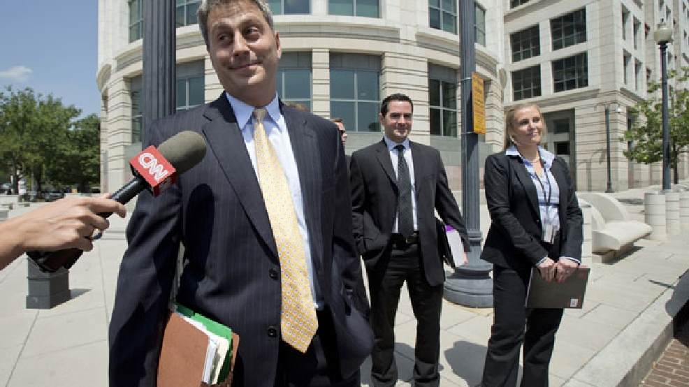 Assistant U.S. Attorney Michael DiLorenzo, left, lead prosecutor in the federal case against Libyan militant Ahmed Abu Khattala, accused of masterminding the deadly Benghazi attacks, leaves the federal court in Washington, Wednesday, July 2, 2014. Khattala faced a court appearance where federal prosecutors will argue why he should remain in detention. The hearing for Ahmed Abu Khattala is before Magistrate Judge Deborah A. Robinson. (AP Photo/Manuel Balce Ceneta)