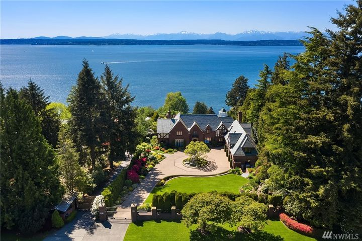 "In Seattle's Magnolia neighborhood sits a beautiful $13.5 million historic home, built in 1929 by George Wellington Stoddard for H.W. Parish, the editor of The Seattle Star. The house still has its original hand-hewn woodwork, leaded glass windows and Waterford crystal chandelier. The most recent owners were Harold and Rita Daubenspeck, who owned several fishing and packing businesses here and in Alaska. They updated it, added stunning gardens and even a custom NikeGrind putting green once featured in promotional materials for the U.S. Open in Chambers Bay! The 4 bed/7 bath home is over 7,000 square feet, sits on 1.04 acres and boasts panoramic views. More info{&nbsp;}<a  href=""https://www.windermere.com/listing/WA/Seattle/2857-Magnolia-Blvd-W-98199/110113203"" target=""_blank"" title=""https://www.windermere.com/listing/WA/Seattle/2857-Magnolia-Blvd-W-98199/110113203"">online</a>. (Image: Windermere /{&nbsp;}Clarity NW Photography - Ryan Slimak)"