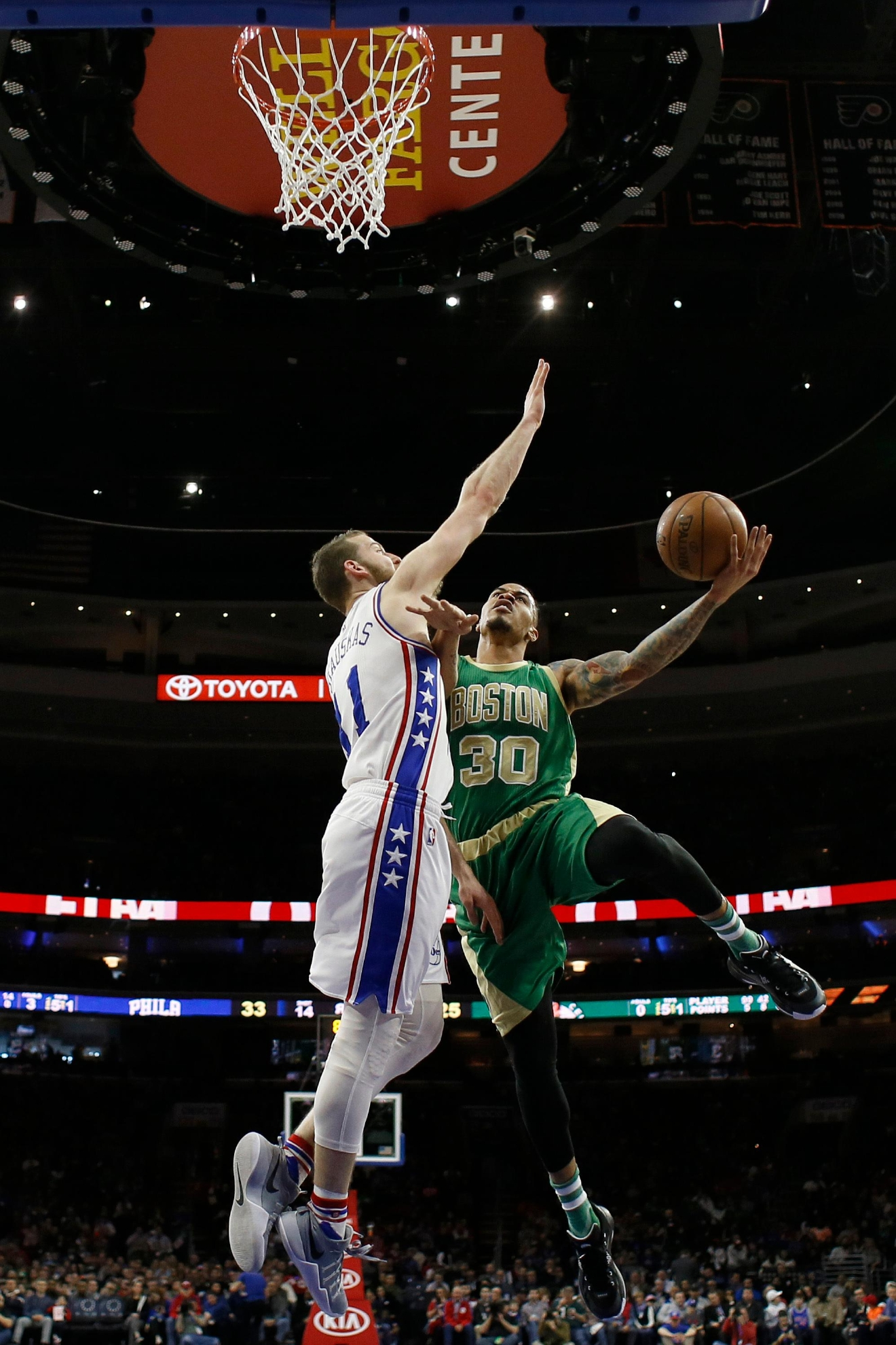 Boston Celtics' Gerald Green, right, goes up to shoot against Philadelphia 76ers' Nik Stauskas during the first half of an NBA basketball game, Sunday, March 19, 2017, in Philadelphia. (AP Photo/Matt Slocum)