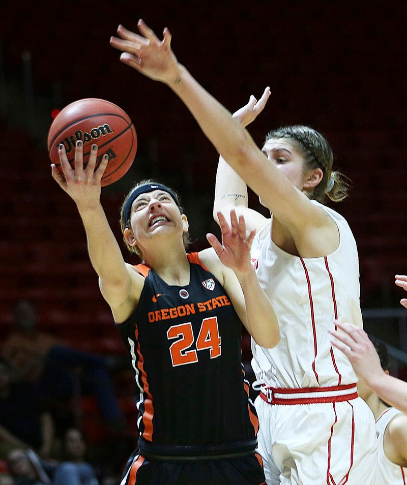 Oregon State guard Sydney Wiese (24) shoots against Utah forward Emily Potter (12) during an NCAA college basketball game in Salt Lake City on Sunday, Feb. 19, 2017. (Scott G Winterton/The Deseret News via AP)