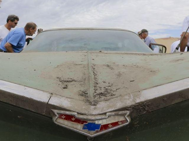 Car buffs look over a 1959 Chevrolet Bel Air 4-door sedan -- the Chevy with the bat-wing fins -- for sale in the auction of vintage cars and trucks from the former Lambrecht Chevrolet dealership in Pierce, Neb.