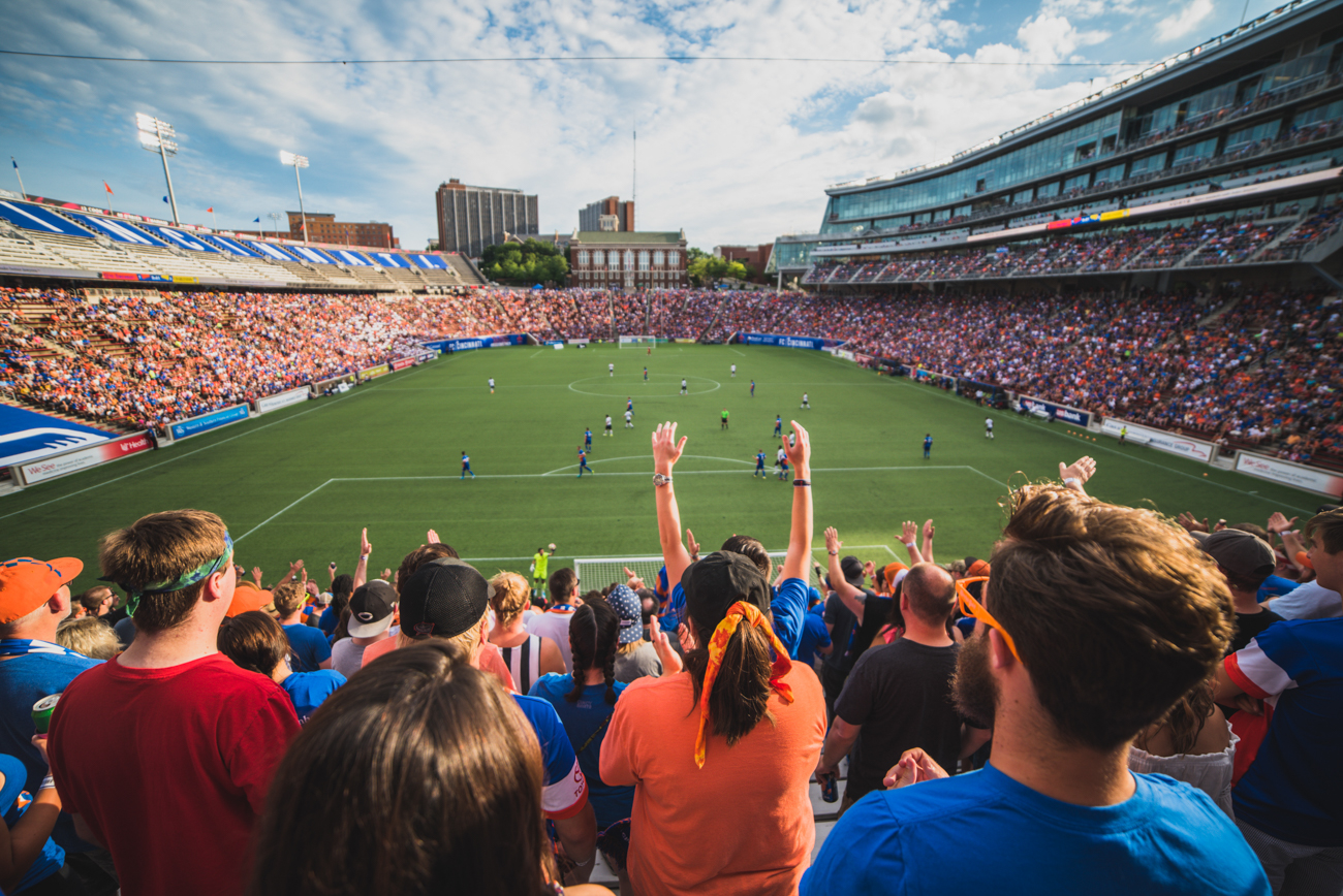 FC Cincinnati's tour de force is due in large part to its amazingly enthusiastic fans. They show up to every home match at Nippert Stadium wearing blue and orange, waving the checkered flag, and marching into the stands while chanting loudly, ushering in a palpable energy rarely seen for a not-yet-MLS team. Without question, attending a FCC match is unlike any other local sporting event. Pictured: June 17 match against Charleston Battery / Image: Louis Rideout // Published: 7.6.17