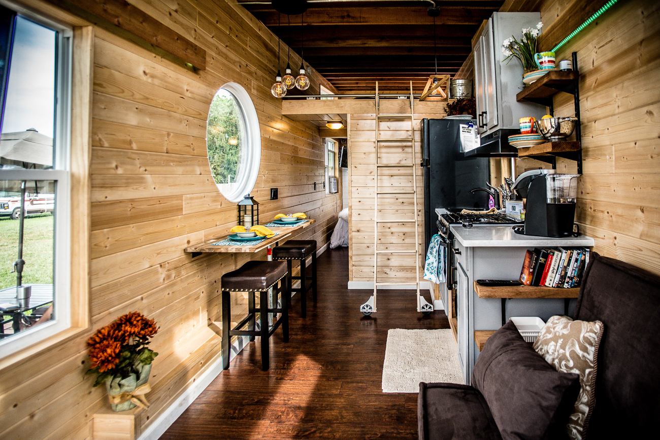 An aroma of pinewood fills the inside of the tiny home. It includes a full bathroom, a loft with a king-size mattress, and a first-floor bedroom with a full-size mattress. The kitchen features quartz countertops, a stove, and a convection oven. Just outside of the house is a private deck with outdoor furniture and a grill. Beyond the tiny house, the marina itself has a full restaurant and bar, as well as live entertainment on the weekends. / Image courtesy of Natalie Gregory // Published: 9.3.19