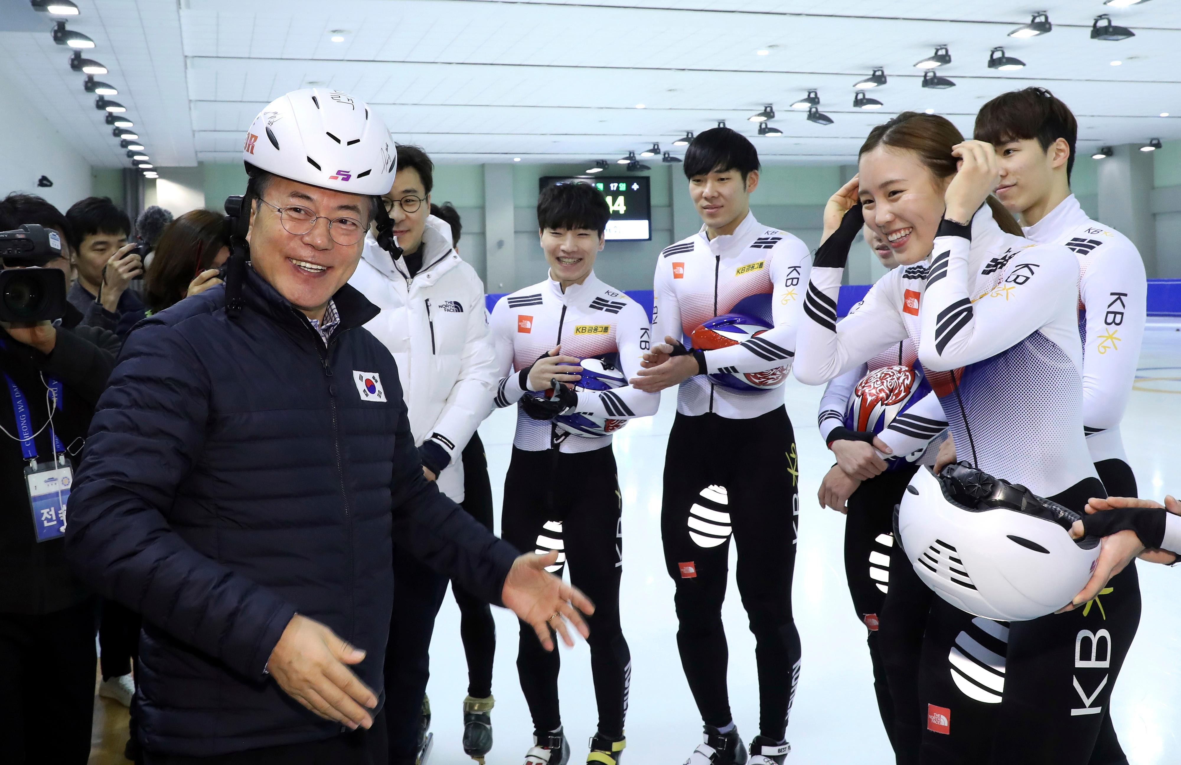 South Korean President Moon Jae-in, left, poses while meeting with South Korean national short track skaters during a visit to Jincheon National Training Center in Jincheon, South Korea, Wednesday, Jan. 17, 2018. (Ha Sa-hun/Yonhap via AP)