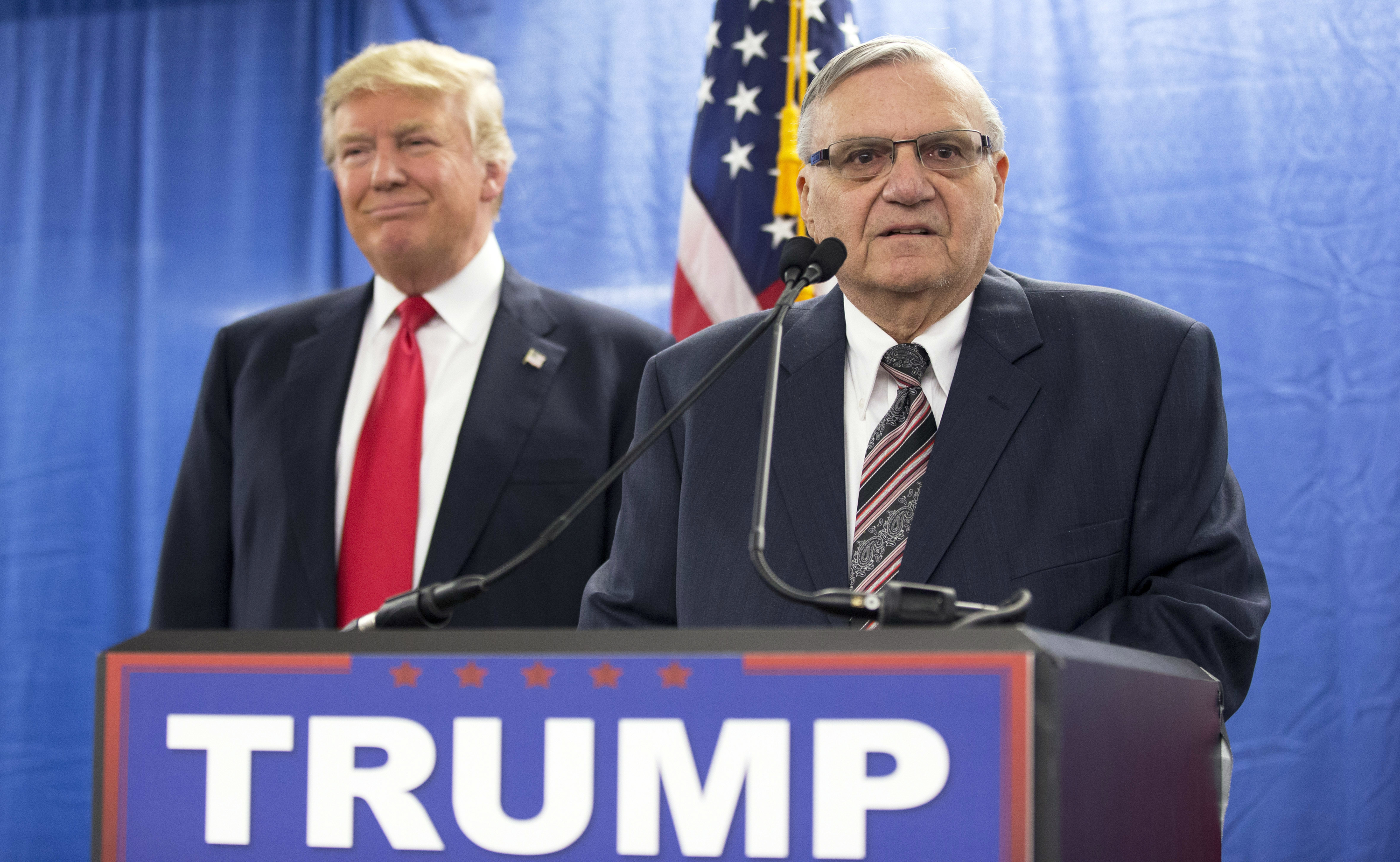 "FILE - In this Jan. 26, 2016 file photo, Republican presidential candidate Donald Trump, left, is joined by Maricopa County, Ariz., Sheriff Joe Arpaio during a new conference in Marshalltown, Iowa. President Donald Trump has pardoned former sheriff Joe Arpaio following his conviction for intentionally disobeying a judge's order in an immigration case. The White House announced the move Friday night, Aug. 25, 2017, saying the 85-year-old ex-sheriff of Arizona's Maricopa County was a ""worthy candidate"" for a presidential pardon. (AP Photo/Mary Altaffer, File)"