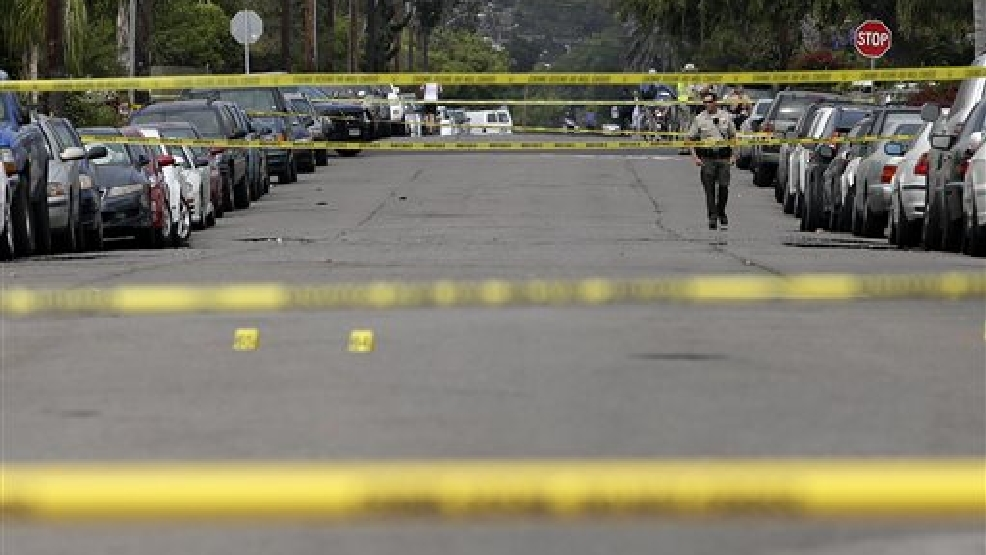 A Santa Barbara County deputy sheriff walks along the street near the scene of a shooting on Saturday, May 24, 2014, in Isla Vista, Calif. A drive-by shooter went on a rampage near a Santa Barbara university campus that left seven people dead, including the attacker, and others wounded, authorities said Saturday. (AP Photo/Jae C. Hong)