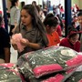 Canutillo students surprised with Santa, warm jackets and teddy bears