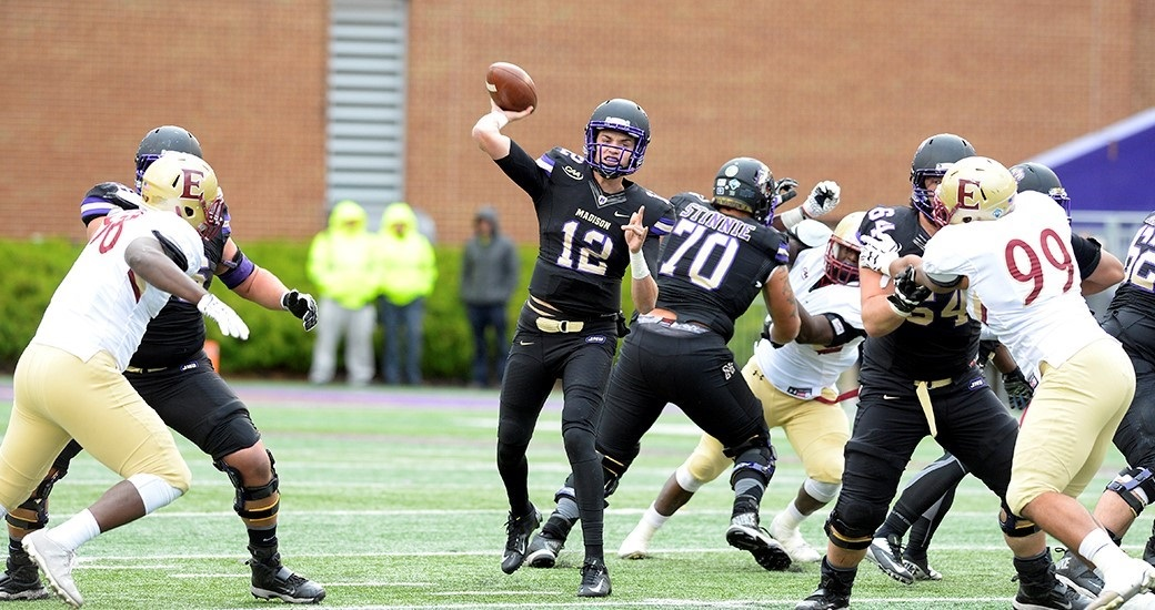 JMU 63, ELON 14: Freshman Cole Johnson (12) threw for 274 yards and 2 TDs on 12-of-13 passing in his first start and Khalid Abdullah rushed for 125 yards and a score in the regular-season finale against Elon (2-9). JMU (10-1) went undefeated in CAA Football play (8-0) for second time in school history and won 10 games for the fourth time. (Photo courtesy JMU Athletics)